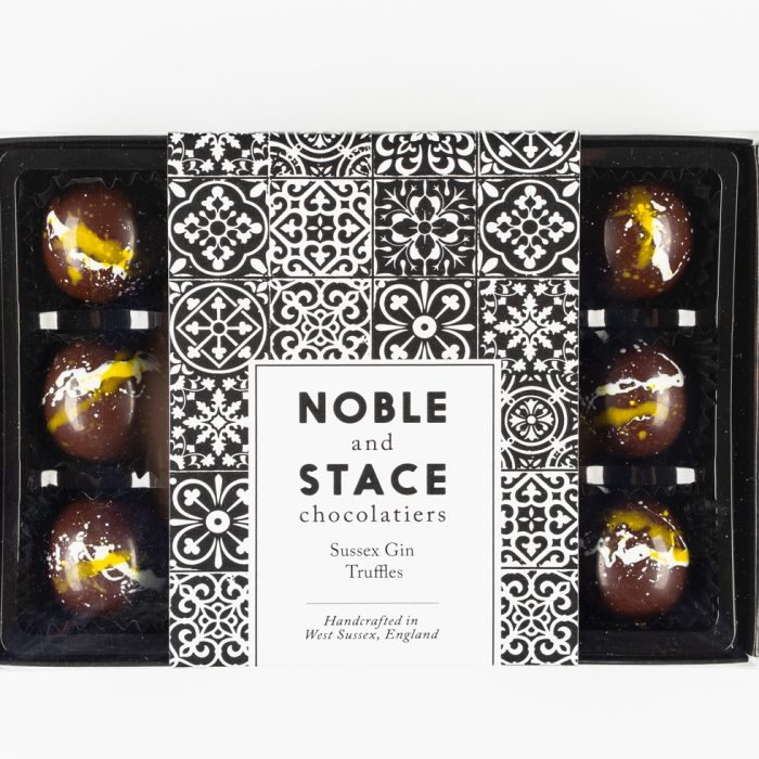 Labelled box of 12 Sussex Gin chocolate truffles decorated with splashes of white and yellow
