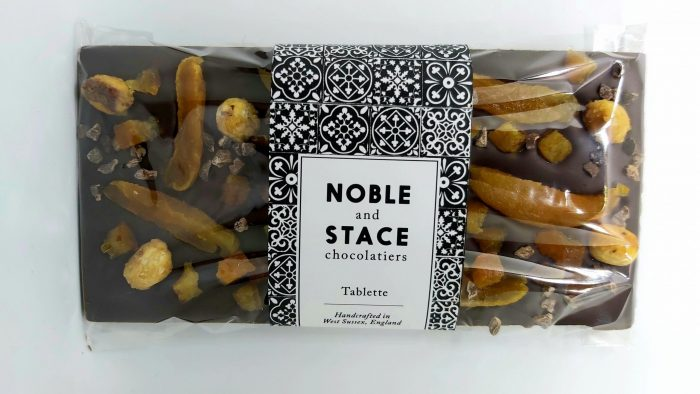 Large chocolate tablette covered in apricots, hazelnuts and orange cubes